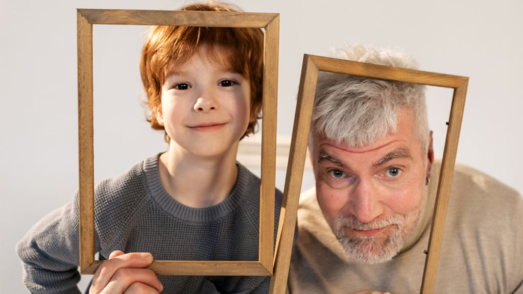 Photo of a grandfather and his grandson acting silly