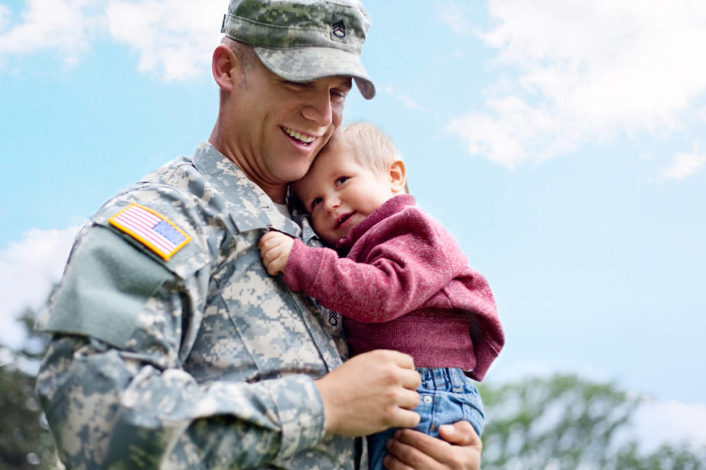 Photo of military father holding son