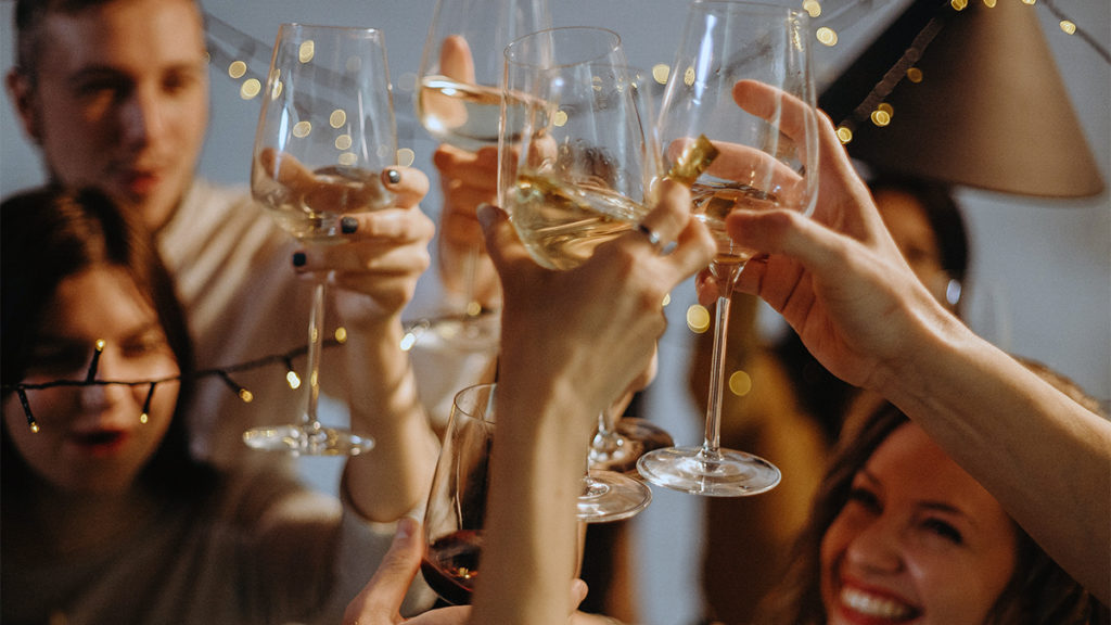 Photo of people toasting at a housewarming party