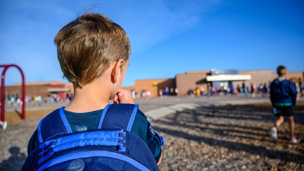 Photo of kid looking nervous at school