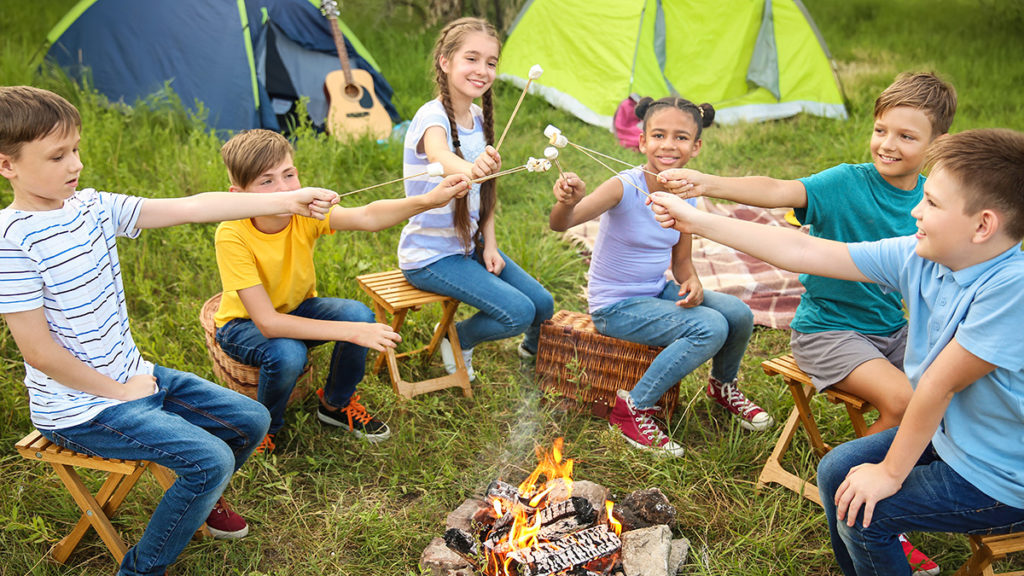 Photo of kids roasting marshmallows at a fall birthday party