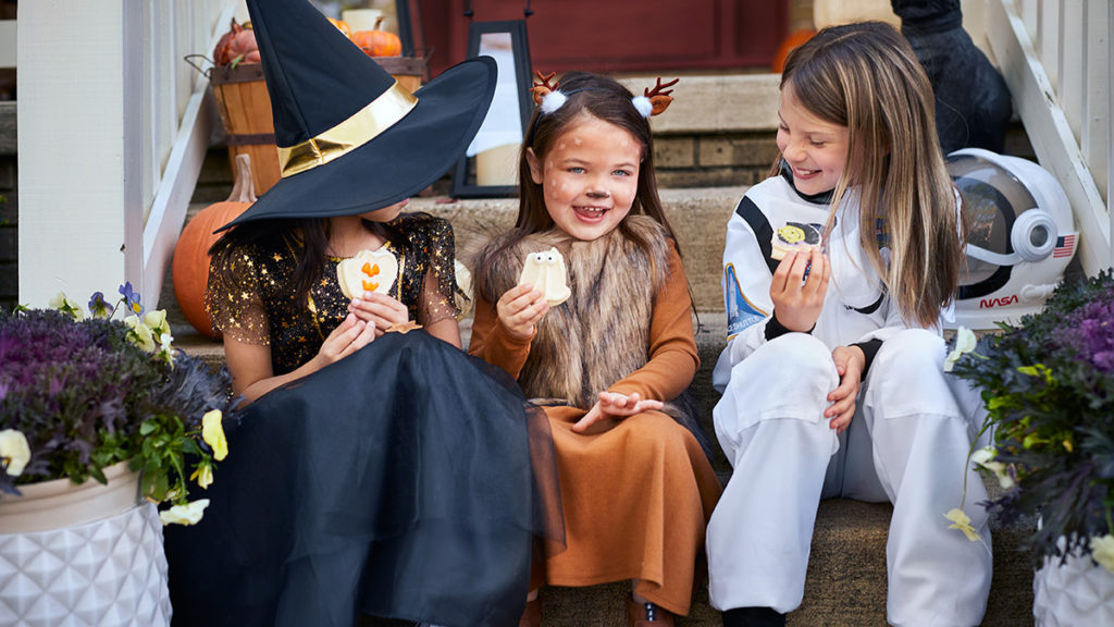 Photo of kids eating cookies at a costume party
