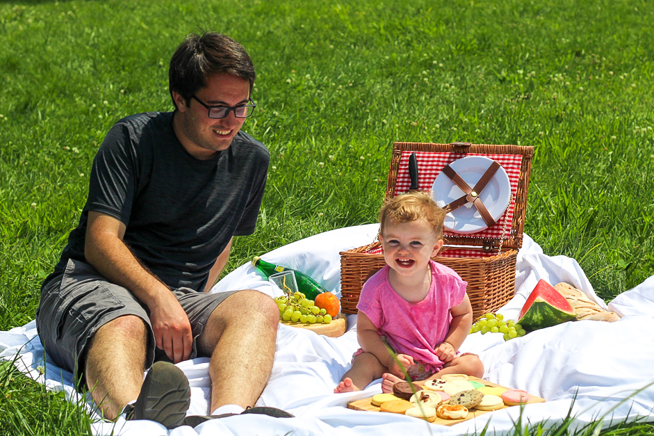 Photo of father and daughter on a picnic, crossing an item off their summer bucket list