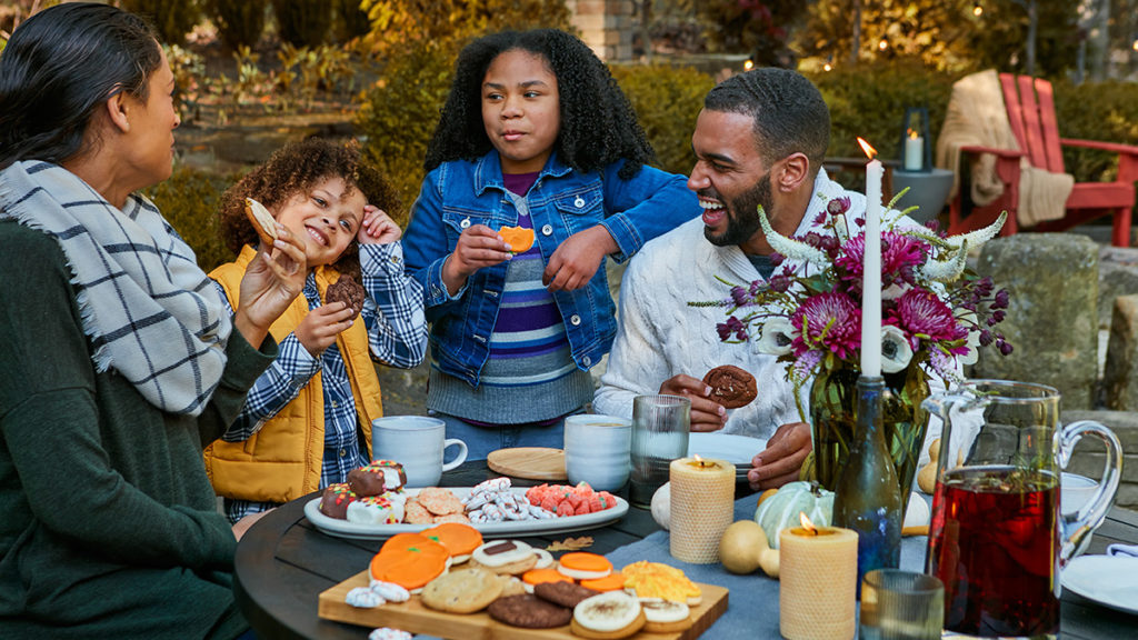 Photo of family eating fall cookies