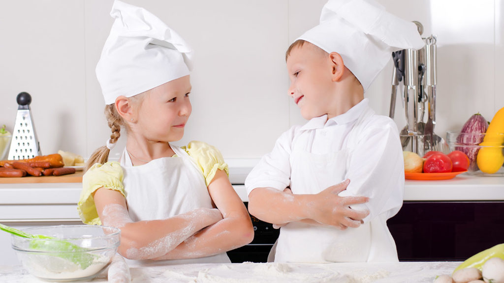 Photo of brother and sister competing in a bake-off