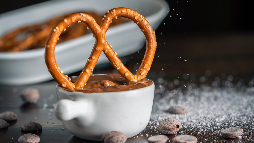 Photo of a pretzel dipped in chocolate