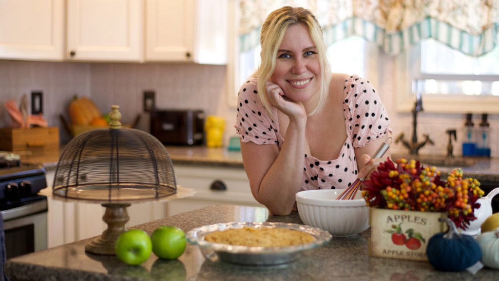 Photo of Jackie Rupp in the kitchen baking a pie