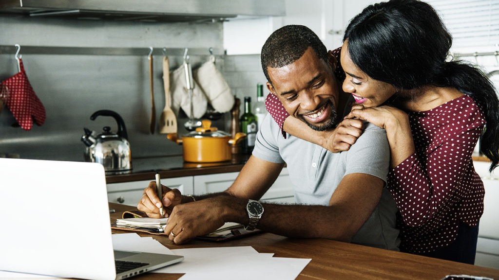 Photo of couple making a bucket list for an at home date night