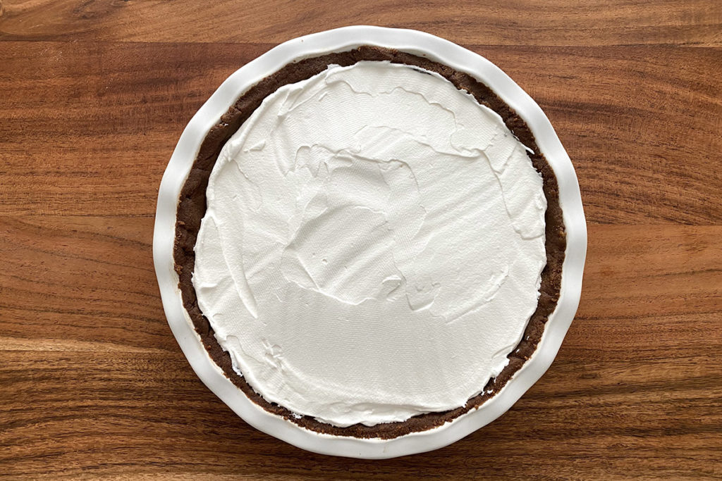 Photo of pumpkin chocolate pudding pie with frosting