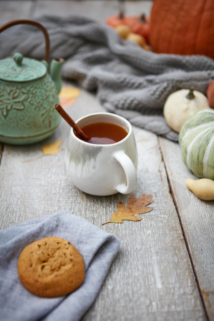 Photo of a mug of cider in a fall setting