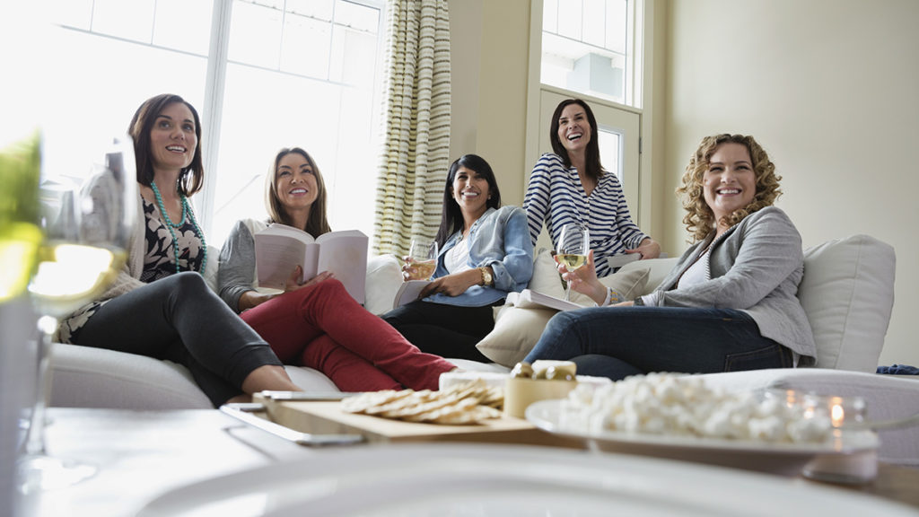 Photo of women drinking wine at a book club event