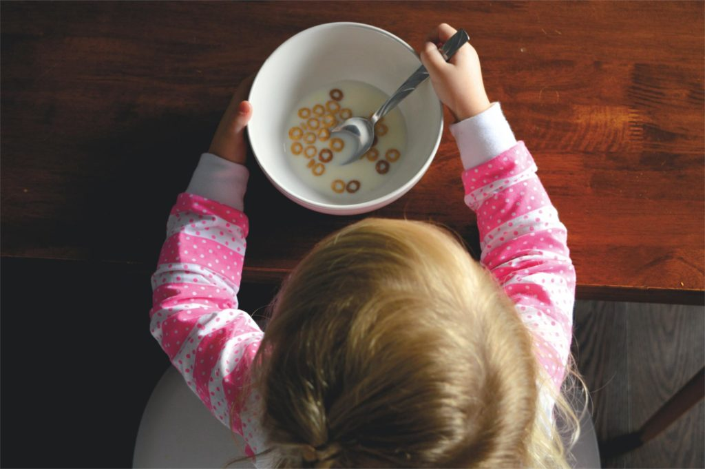 Photo of a girl eating cereal