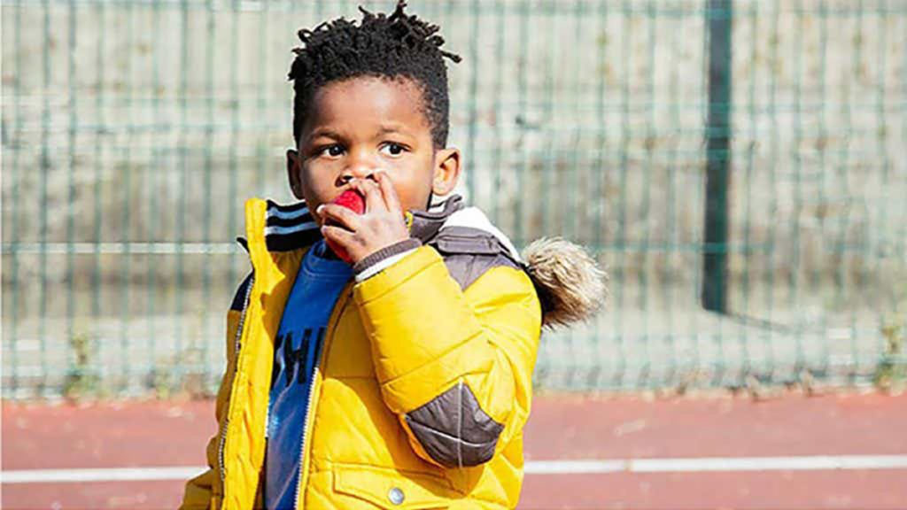 Photo of a boy eating an apple