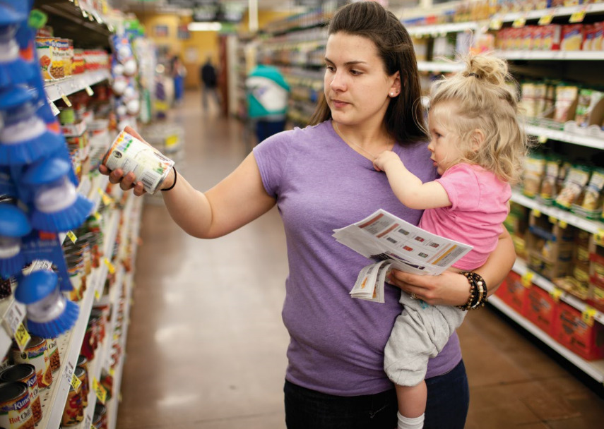 Photo of mother and daughter shopping for food