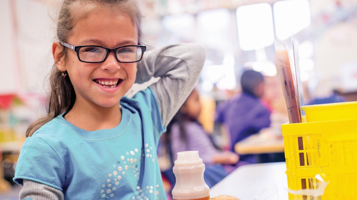 Photo of smiling girl for No Kid Hungry