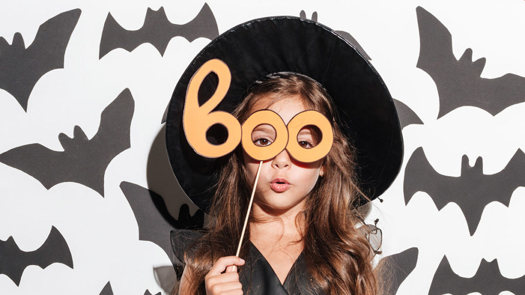 Photo of girl with boo mask
