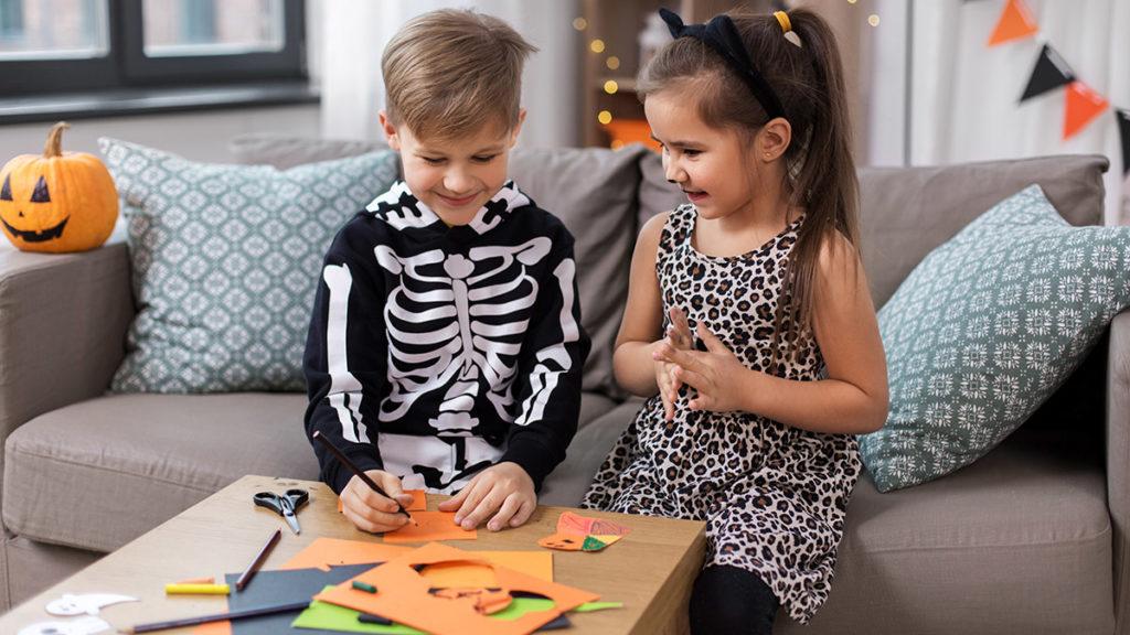 Photo of kids making Halloween crafts